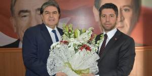 AK PARTİ İL BAŞKANI AY'DAN MHP'Lİ BAŞKANA ZİYARET