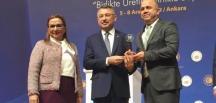 TİCARET MÜDÜRÜ EKİZ'E OKTAY'DAN PLAKET